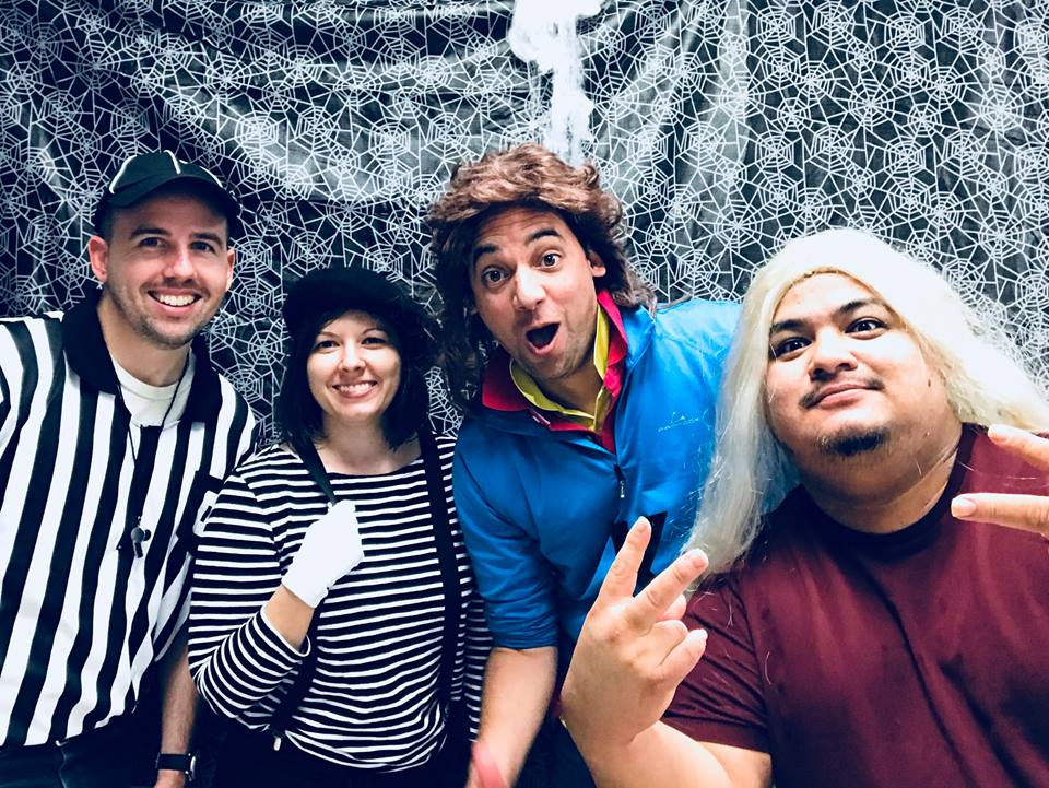 Employees dressed up in Halloween costumes