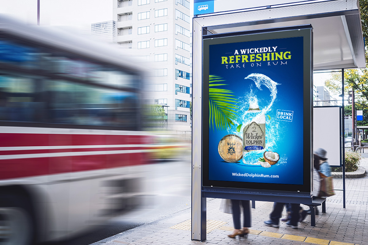 ad on bus stop we created for wicked dolphin