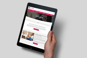 hand holding tablet showing one of the web sites we built